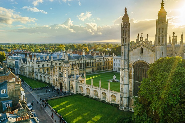 Kings College with sun flare at sunset in Cambridge